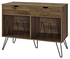 Take it back in time with the Novogratz Concord turntable stand with drawers The medium brown wood grain laminated particleboard and MDF offer a strong build that complements the mid century inspired black metal hairpin legs The double wide stand off...