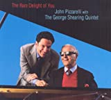 "album cover: John Pizzarelli and the George Shearing Quintet ""The Rare Delight of You"""