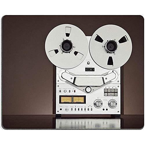 Primo piano dettagliato d'annata del registratore della piattaforma del nastro della bobina aperta stereo analogico di identificazione di Mousepad di gomma naturale del cuscinetto di topo