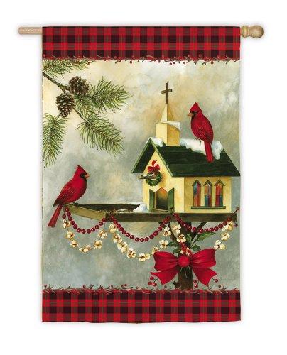 Maison de Noël dans le jardin Drapeau