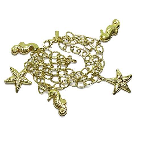 Preciosa pulsera de oro amarillo de 18k con 3 cadenas de eslabones entrecruzadas con 5 motivos grandes, 3 caballitos de mar y 2 estrellas de mar, 18.50cm de larga con cierre mosquetón. 13.20gr de oro