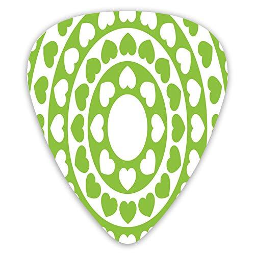 12 púas de guitarra, motivos en círculos con motivos de ojo, diferentes tamaños de púas de guitarra