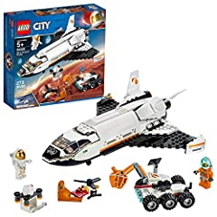 Build an exciting space shuttle toy model that offers plenty of imaginative action possibilities and a Mars rover with articulated grappling arm to retrieve geodes! Includes 2 LEGO City Mars astronaut minifigures, plus a helidrone and storage drone 2...