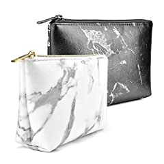 Comes with 2 bags. One black and one white. Super Cute - If you need a good, clean, matching set of cosmetic bags to travel with. This bag is adorable, cleans up well, and holds a lot. High Quality Material - Made of waterproof PU leather, durable, s...