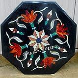 Mesa de centro de mármol negro octagonal con incrustaciones de piedra cornalina