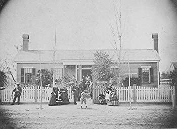 A Family In Front Of Their Home In Aiken South Carolina  Note The Boy In Front Showing His Prowess With His Bow And Arrow  At The Far Left A Black Man Poses Wearing His Hat And Holding A Staff On The
