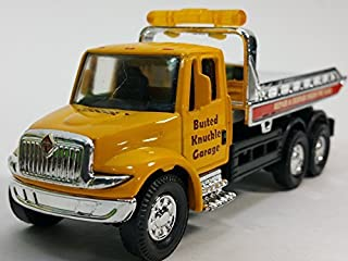Showcast International Yellow Busted Knuckle Garage Flatbed Tow Truck Functional Rollback Wrecker 1/64 Scale Commercial Vehicle by Showcast