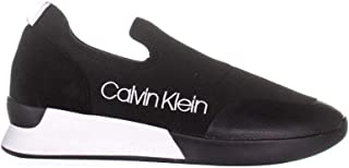 Women's Que Slip-On Sneaker, Black, 6.5 M