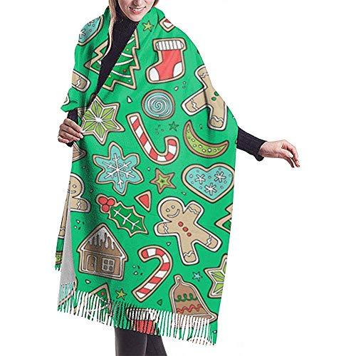 Regan Nehemiah Kerstkerstfeestdagspeperkoeken-man-koekjes-winter-snoepjes-feestelijkheden op groene sjaal-verpakking winter-warme sjaal-kap kasjmier-sjaalverpakking