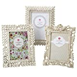 LEAF BORDER - (Top Middle) Hand painted in white and finished with silver accent the frame has three layers of leaf borders with an inner beaded border highlighting the picture. Holds 4 x inch photo. Outer dimensions are 8.5 x 6.5 inch LAVISH OPENWOR...