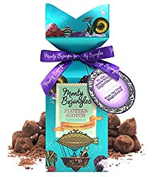 Curiously moreish cocoa dusted luxury truffles in a beautiful gift box. Divine cocoa dusted truffles with creamy Butterscotch chips and a cheeky hint of sea salt. Over 16 Great Taste Award winning Monty Bojangles truffles in this gift box. A swing ti...