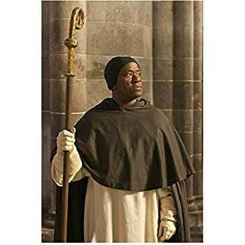The Hollow Crown 8inch x 10inch Photo Lucian Msamati Wearing All Black & White Holding Staff Pose 2 kn