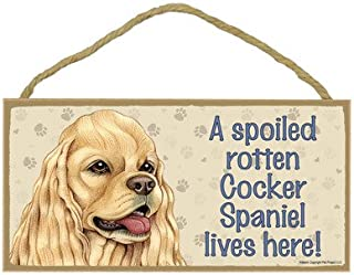 A spoiled rotten Cocker Spaniel (American, tan color) lives here wood sign plaque 13cm x 25cm