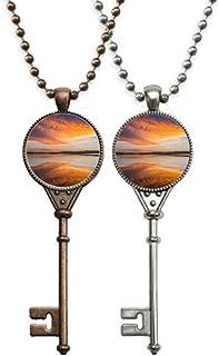 Collier avec pendentif en forme de clé - Motif : lever de soleil, océan, ciel, nuage, réflexion de la clé
