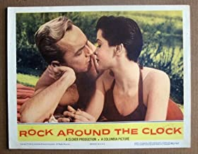 DK44 Rock Around The CLock STEVE HOLLIS '56 Lobby Card.  Here s a terrific lobby card from the original release of the quintessential 50s Rock N Roll movie ROCK AROUND THE CLOCK featuring a great image of STEVE HOLLIS and CORINNE TALBOT. The film featured Bill Haley and the Comets.     Lobby card is in EXCELLENT+ condition. A few pinholes, no stains, no tears.       A lobby card is an 11 x 14 inch placard advertising a movie. They were displayed in the theatre lobby to entice moviegoers to go to the box office and buy a ticket.