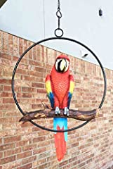 "This Scarlet Macaw Parrot Hanging sculpture measures 13.5"" tall overall with the parrot alone being 10"" tall. It is 3"" deep and the branch that the parrot sits on is 8"" in length. The ring diameter is 9.5"" and the chain is 17"" long. These measurement..."