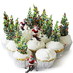 """- Cakegirls Santa Skier Pine Tree Snowflake Confetti Cupcake Display Kit - (3) Miniature Skier Cupcake Toppers- 1 3/4"""" Tall x 2"""" Wide - (12) Pine Tree Novelty Toppers - 4"""" Tall - (30) Metallic Silver Foil Baking Cups - (2.8 oz) Primary Color Confetti..."""