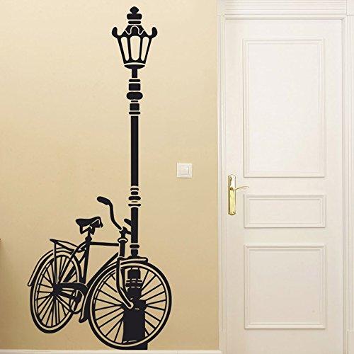 IDEAVINILO Vinilo Decorativo Bicicleta apoyada en una farola. Color Negro. Medidas: 50x120cm