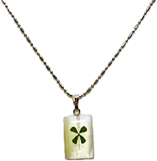 Four leaf clover necklace, pendant on cat eye stone or shell