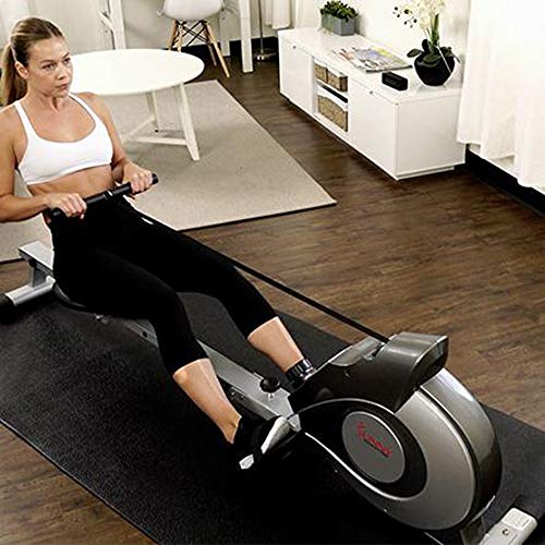 Lady at home working out on a Sunny Health Rowing Machine