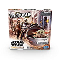 """IMAGINE RESCUING THE CHILD: Pop the Pop-O-Matic die roller and move the character pawns around the board. The race is on to rescue The Child -- the character often called """"Baby Yoda"""" INSPIRED BY THE SERIES: This edition of the Trouble board game is i..."""