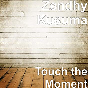 Touch the Moment