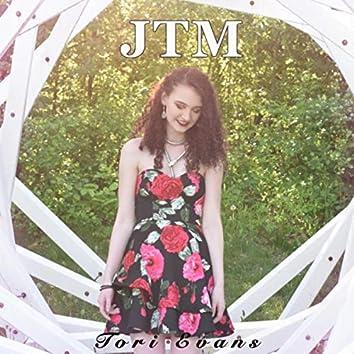 J.T.M.