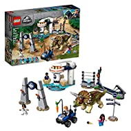 This LEGO Jurassic World dinosaur toy includes 4 new-for-June-2019 minifigures: Owen Grady, Simon Masrani, Allison Miles and a tourist Buildable Triceratops figure features a posable head and legs to escape through a collapsible fence with a 'Danger ...