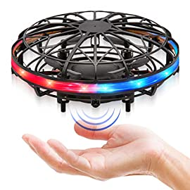 Force1 Scoot LED Hand Drone for Kids - Kids Drone, Flying Ball Drone, Light Up Toys for Boys and Girls (Matte Black) 6 ULTRA BRIGHT LED SCOOT DRONE: This hand operated drone for kids features super-bright LEDs that light up this UFO flying toy with red, white and blue EASY TO FLY KIDS DRONE THAT FLIPS: These hand controlled drones use infrared sensors to navigate and perform 360° flips; each small drone features a webbed shell to protect hands and walls INDOOR HOVER DRONES: Launch these hands free drones indoors with a gentle toss into the air - no remote control needed; a ring of LED lights shines as you fly these drones for kids in any room