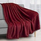 PAVILIA Pom Pom Blanket Throw, Wine Dark Red   Soft Fleece Pompom Fringe Blanket for Couch Bed Sofa   Decorative Cozy Plush Warm Flannel Velvet Tassel Throw Blanket, 50x60