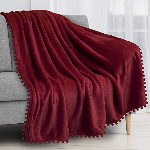 PAVILIA Pom Pom Blanket Throw, Wine Dark Red | Soft Fleece Pompom Fringe Blanket for Couch Bed Sofa | Decorative Cozy Plush Warm Flannel Velvet Tassel Throw Blanket, 50x60