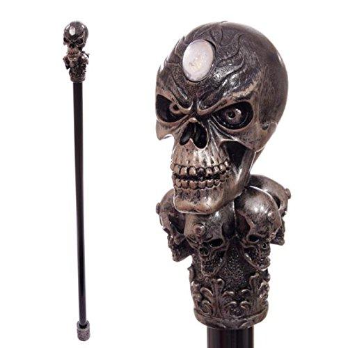 Schwarze Gehstock mit bronzefarbenem Totenkopf auf Totenköpfe