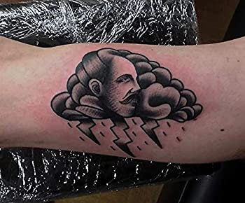chest tattoo with clouds