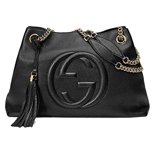 "Gucci dustbag included. Made in Italy. Details: Pebble leather. Light fine golden hardware. Double chain shoulder straps with leather shoulder pad; 7"" drop. Detachable leather tassel. Inside hook closure. Embossed interlocking G. Natural cotton linen..."