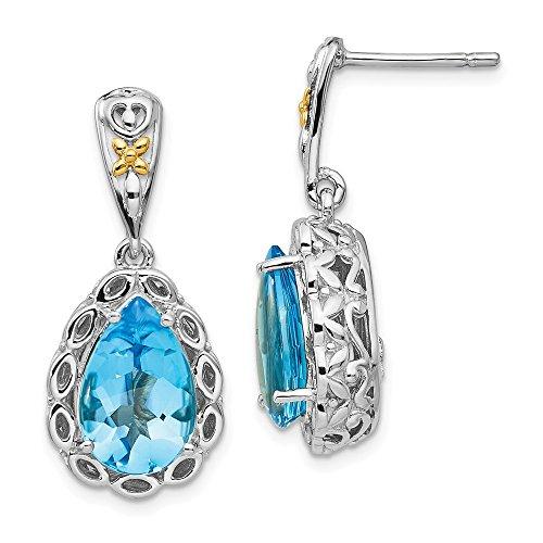 Pendientes de tuerca de oro de 14 quilates y plata de ley con topacio azul para mujer.
