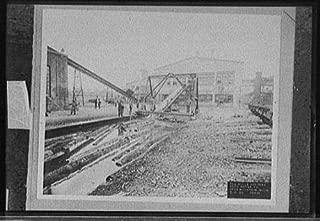 Photo: Saw mill,hot pond,lumber,cars,Ford Motor Company,Iron Mountain,Michigan,MI,1924