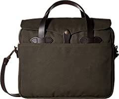 The toughest, most dependable briefcase you'll have for seasons to come. Interior features one main compartment for all essentials, two full length open pockets, one business card pocket and one cell phone pocket. Water resistant storm flap with brid...