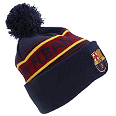 Knitted hat with FC Barcelona detail. Features the club crest, FC Barcelona text design and pom pom on top. Turn up cuff. 100% Acrylic.