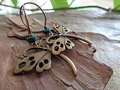 ⊹⊱  BRONCE VINTAGE DRAGONFLY & TURQUOISE WOOD RONDELL  ⊰⊹ Pendientes vintage de bronce con pájaro y grandes ganchos para las orejas
