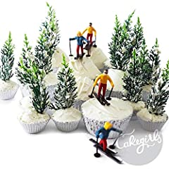 """- This Cakegirls Skier Tree Cupcake Kit includes: - (6) Miniature Skier Cupcake Toppers- 2"""" Tall - (12) Pine Tree Novelty Toppers - 4"""" Tall - (30) Metallic Silver Foil Baking Cups"""