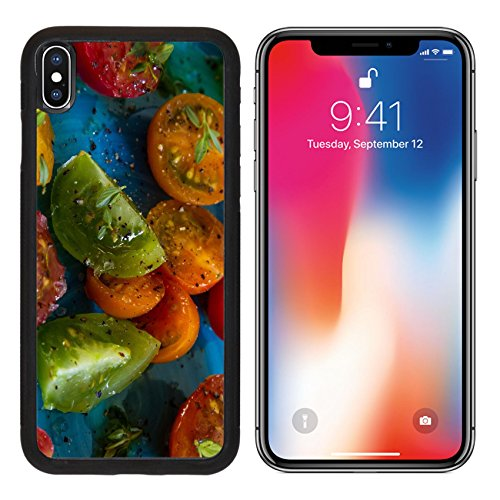 MSD Premium Apple iPhone X Aluminum Backplate Bumper Snap Case IMAGE ID: 29124272 Yellow red green orange tomatoes with olive oil pepper rock salt and sprigs of thyme on a bright blue dish
