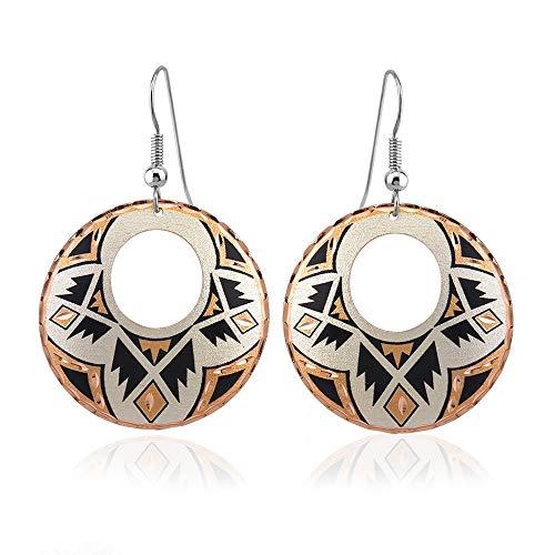 Pendientes de cobre únicos hechos a mano con diseño nativo americano del suroeste.