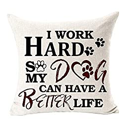 "Linen coloured cushion with the text ""I work hard so my dog can have a better life"" on the front."