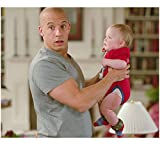 Vin Diesel 8 Inch x10 Inch PHOTOGRAPH The Pacifier (2005) Looking Surprised While Holding Luke/Bo Vink kn