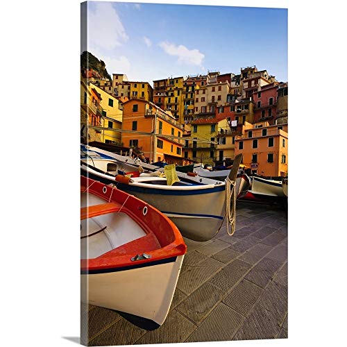Italy, Tuscany, Cinque Terre. Fishing Boats at Rest in Manarola in Cinque Terre Canvas Wall Art.
