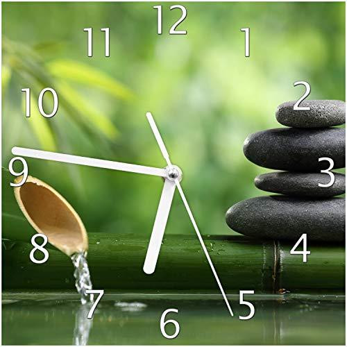 Wallario Glas-Uhr Echtglas Wanduhr Motivuhr; in Premium-Qualität; Größe: 20x20cm; Motiv: Steinstapel und Bambus auf dem Wasser