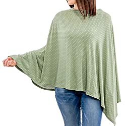 Green nursing poncho on a standing woman wearing jeans