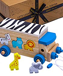 Our beautiful Animal Shapes in Wood fit into this sorting toy featured in a charming pull-along safari design. The development toy set comes complete with 6 adorable wooden animal figurines. The animals included are a zebra, an alligator, a lion, a g...