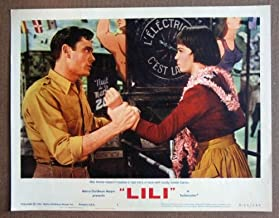 DF34 Lili LESLIE CARON/MEL FERRER mint R64 LC.  Here s a terrific lobby card from the first re-release of LILI featuring a great image of LESLIE CARON and MEL FERRER.    Lobby card is in MINT condition. No pinholes, no stains, no tears.       A lobby card is an 11 x 14 inch placard advertising a movie. They were displayed in the theatre lobby to entice moviegoers to go to the box office and buy a ticket.