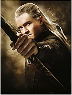 Orlando Bloom 8 inch x 10 inch Photo The Hobbit Pirates of the Carribean Lord of the Rings as Legolas w/Bow Focus on Hand Holding Bow kn